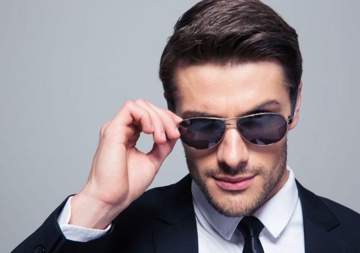Portrait of a fashion businessman in sunglasses