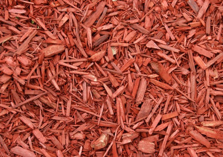 21188802 - a closeup shot of red mulch used for garden decorating.